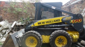 New Holland Kompaktlader L170 Lader Baumaschinen gebraucht Bilder Skid Steere Loader